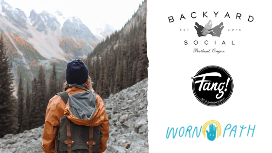 Photo of person overlooking a valley with logos: Backyard Social, Fang!, and Worn Path