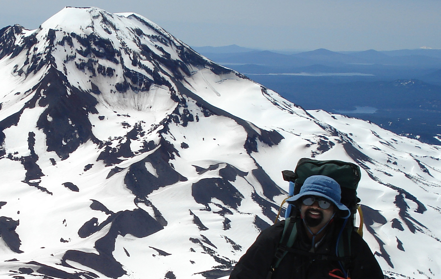 Vik Anantha doing what he loves - summitting an Oregon peak.