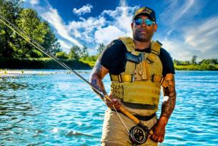 Navy Veteran Chad Brown poses with his fly rod.